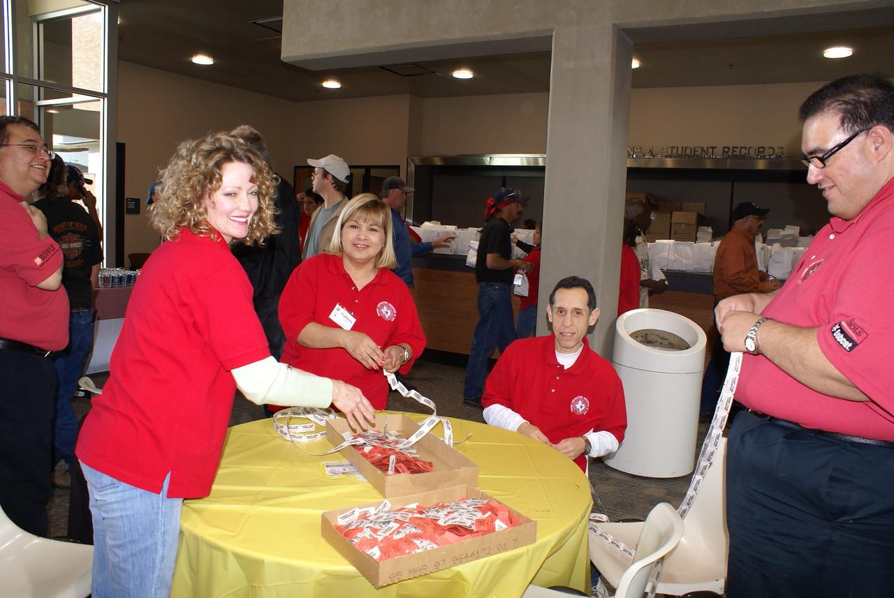 Volunteers:  The HCADFW provided each volunteer with a gift of a red HCADFW logo polo shirt.  (Faith Gatlin, Pat Gorman and Raymond Cervantes - Thank You)