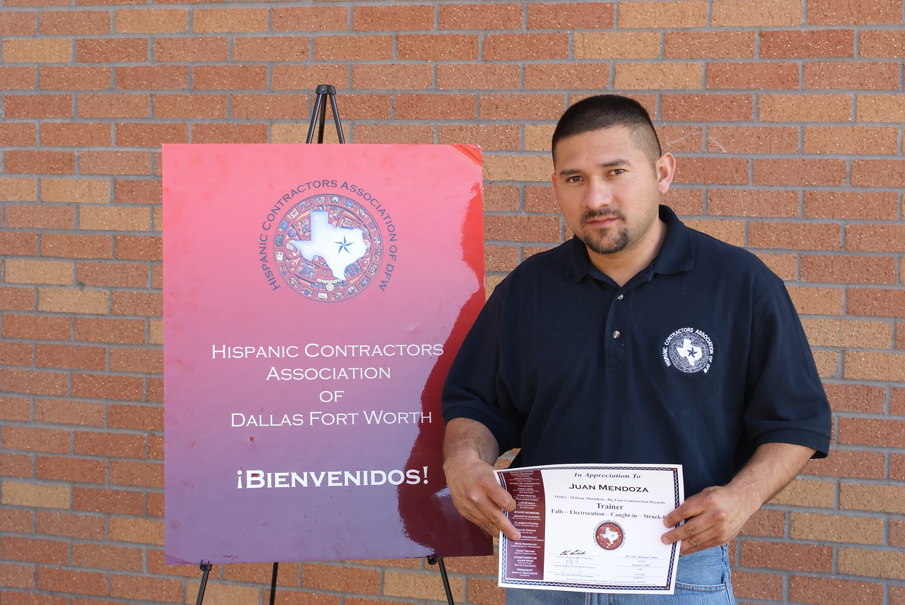 Trainer Juan Mendoza receives a certificate of appreciation presented by the HCADFW Board.