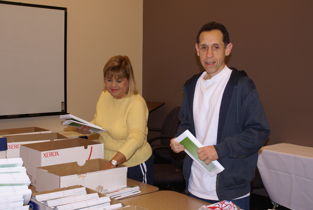 Volunteers Pat Gorman and Raymond Cervantes arrived at 6 a.m. to prepare the OSHA Pocket Guides for the Big Four Construction Hazards Training.  Each construction worker received a complimentary set of four pocket guides in either English or Spanish.