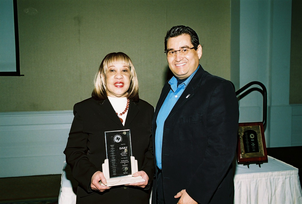 Gloria Dixon with DART receives the HCADFW Partner Recognition from HCADFW Board member Jose Rodriguez