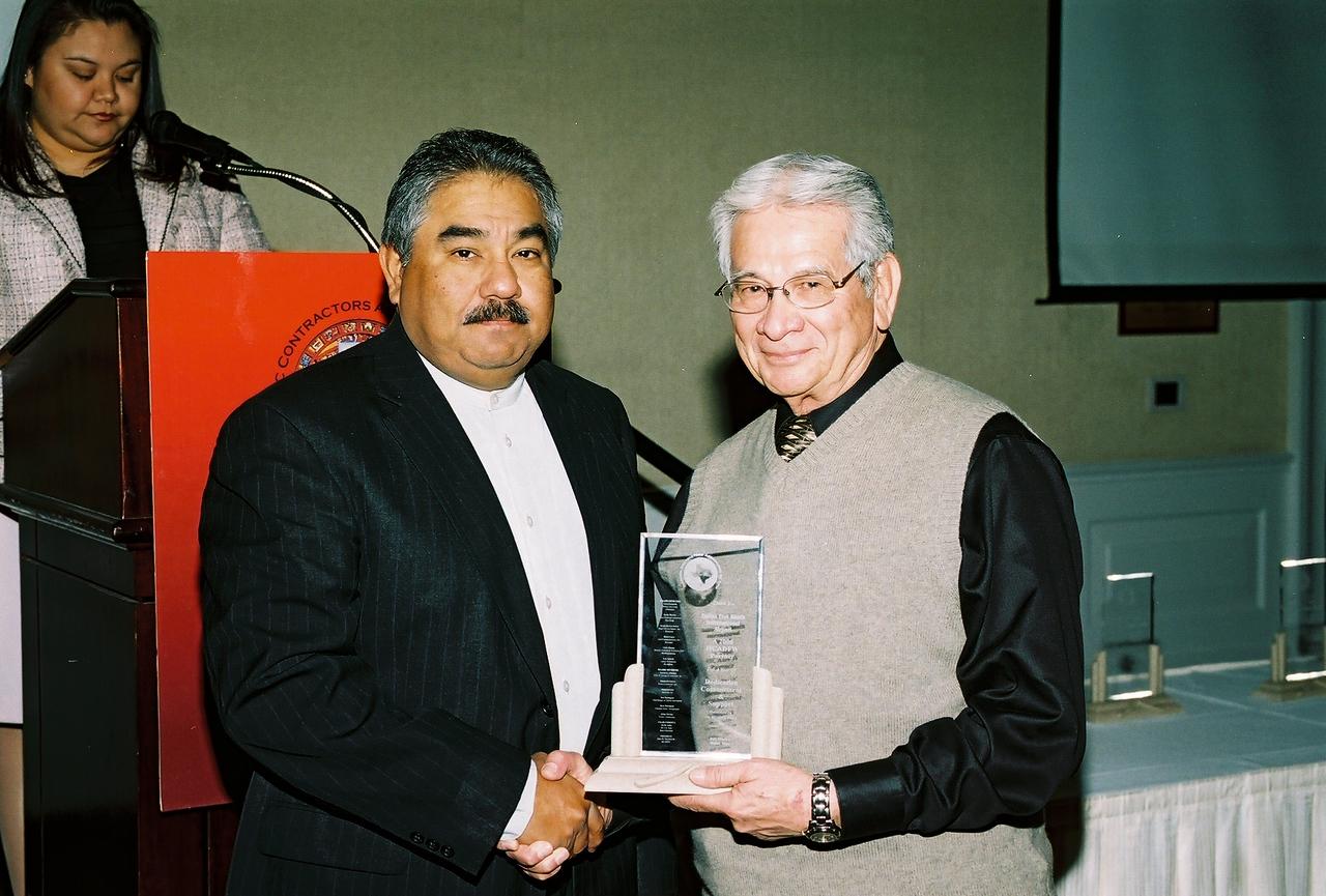 Felix Galan, DFW Airport accepts a HCADFW Partner Recognition from Hank Lopez, HCADFW Board Secretary