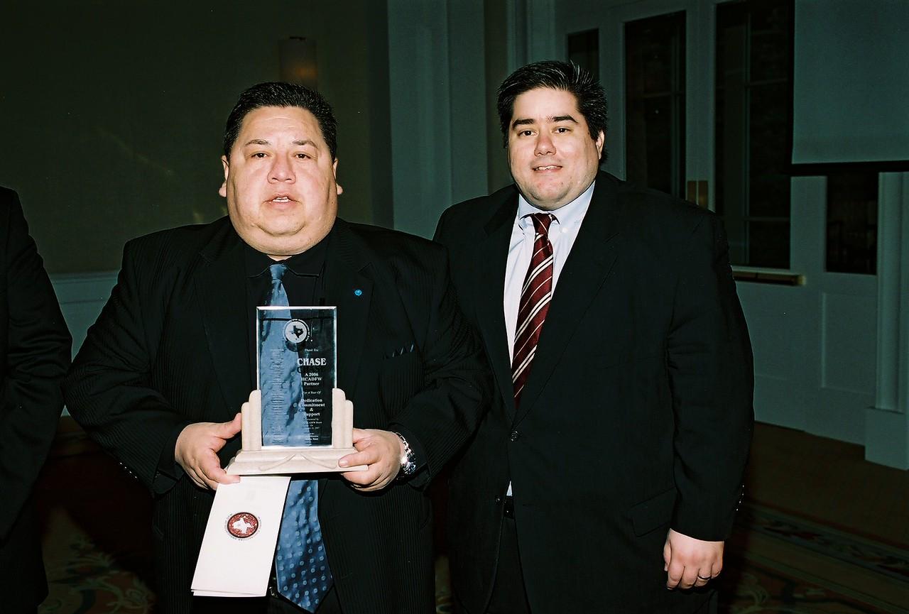 Robert Zuniga accepts a HCADFW Partner Recognition from HCADFW Board Parliamentarian Chris Montez