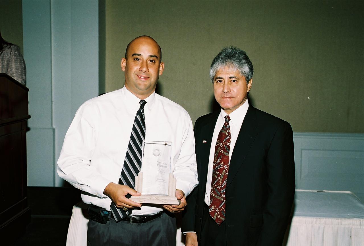 John Martinez with Sherwin Williams receives the HCADFW Partner Recognition from HCADFW Treasurer Sergio De Los Santos, SDS, Inc.