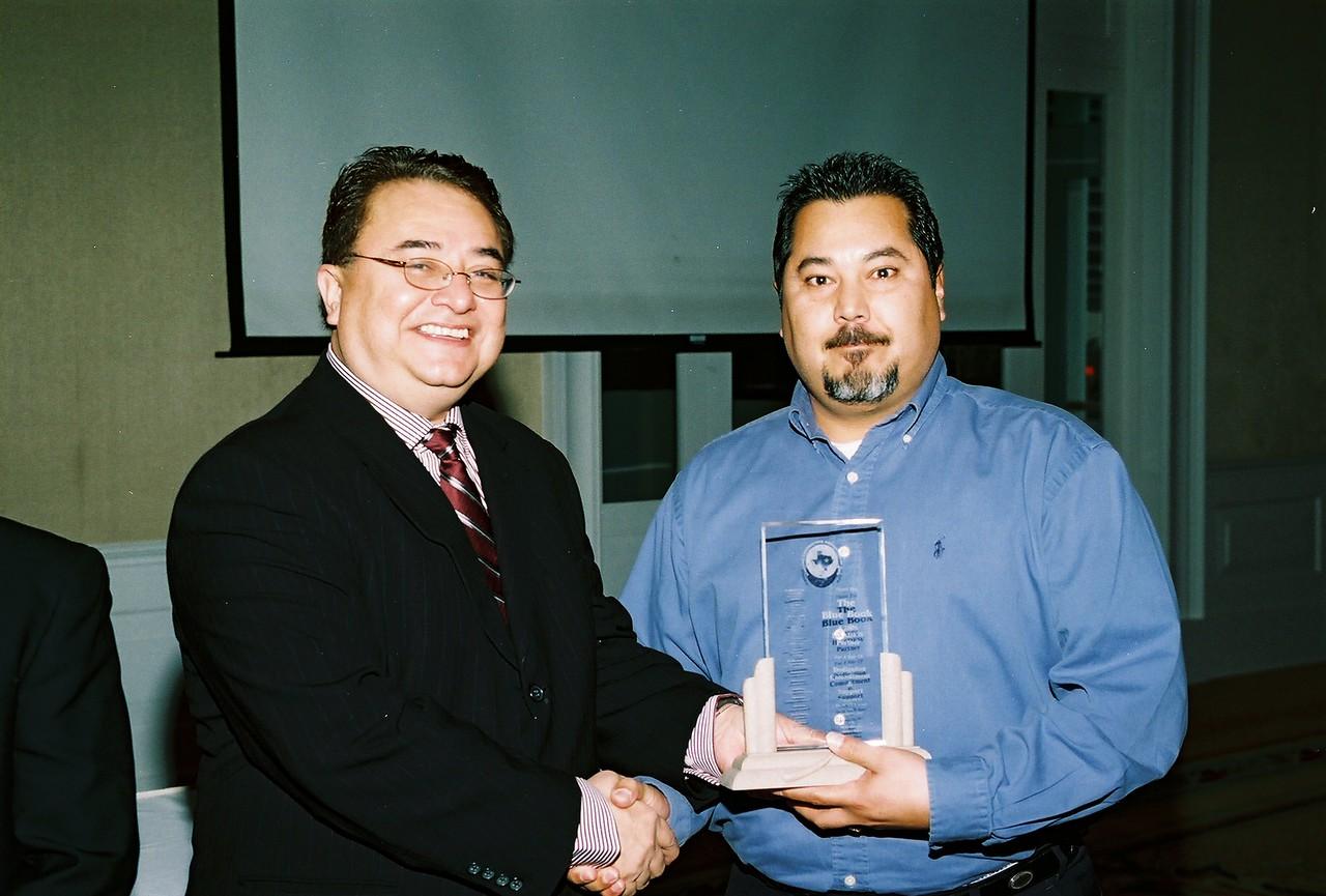 Chris Escobedo, HCADFW Chairman recognizes The Blue Book as a 2006 HCADFW Partner