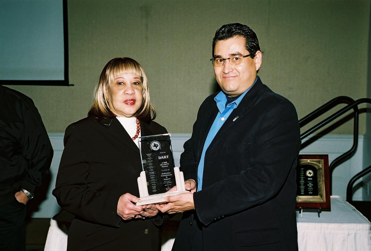 Gloria Dixon, DART accepts a HCADFW Partner Recognition from Jose Rodriguez, HCADFW Board Member