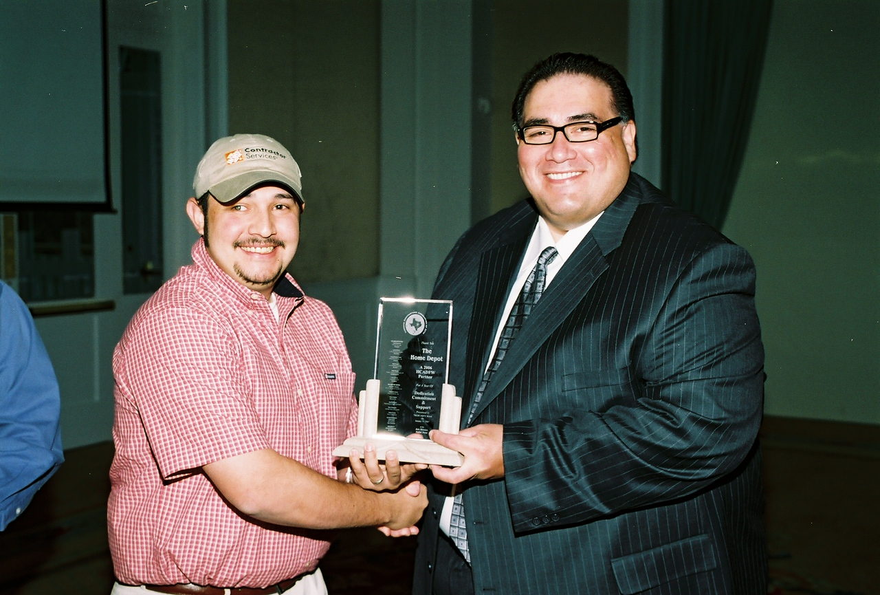 Al Ramirez with Home Depot receives the HCADFW Partner Recognition from HCADFW President John H. Martinez-D.
