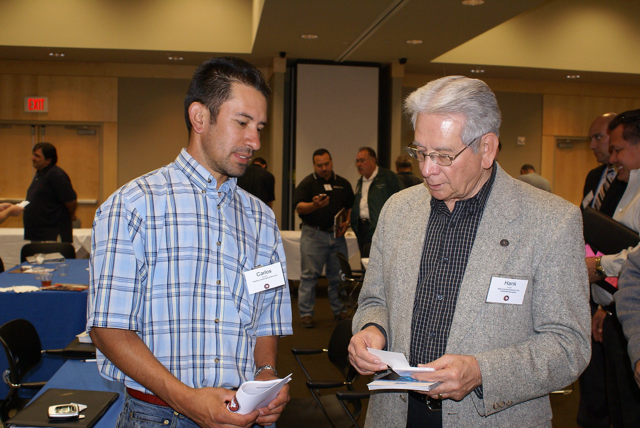Carlos Espitia, Espitia Landscaping Services and HCADFW Board Secretary Hank Lopez, ABLe Communications network at the March 6 HCADFW Monthly Procurement Luncheon