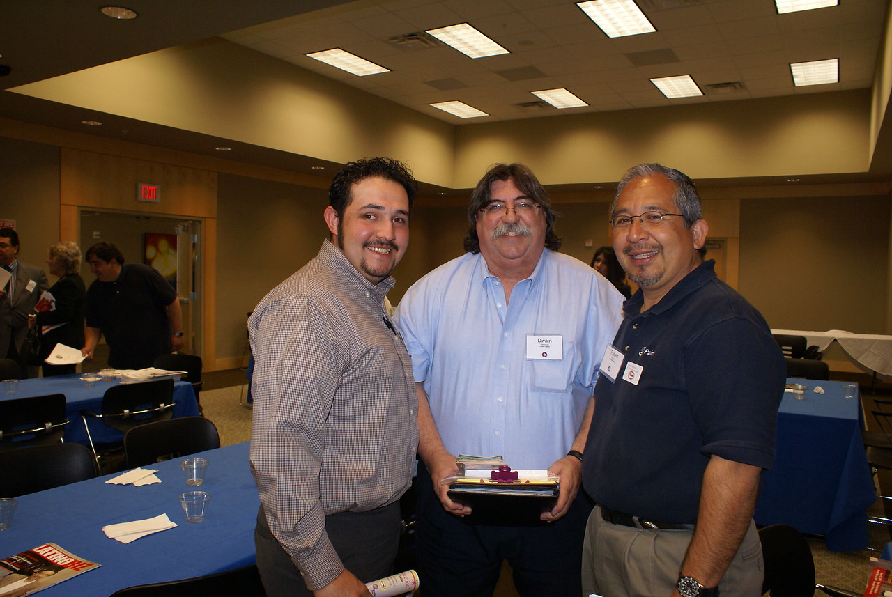 Al Ramirez and Dwain Bierbrauer with Home Depot and Ruben Martinez, ICI Paints