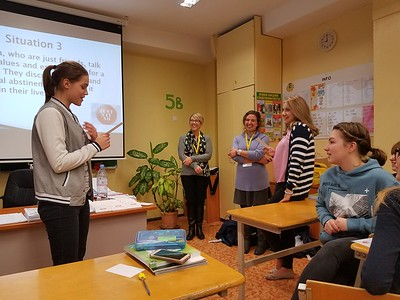 Stephanie White and Abigail Shipley work on interactive role plays with Narva students