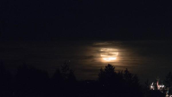 Super Moon shines through clouds