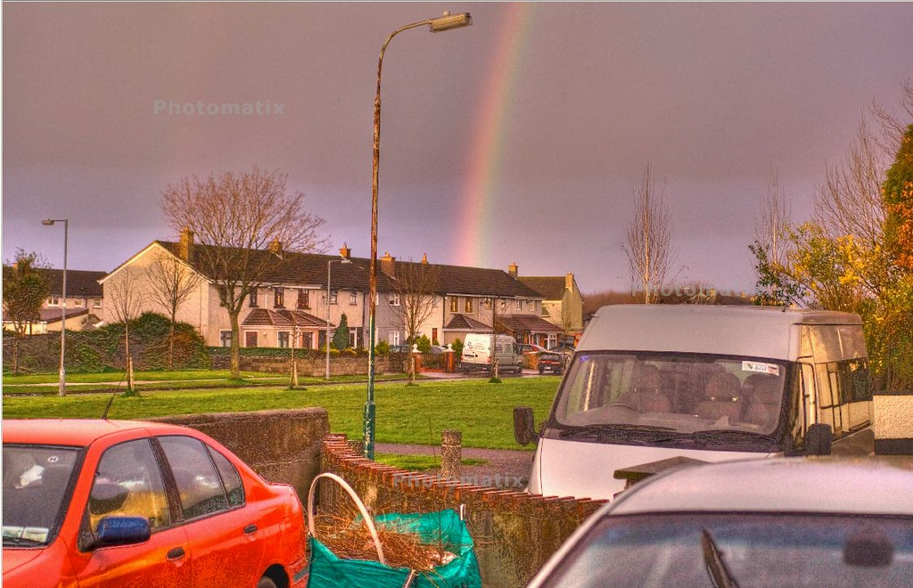 Rainbow, cars and grass, outside the door