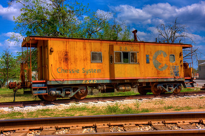 Old train car in Giddings, Tx. March 2009, photo is in HDR.  HDR is a set of techniques that allows a greater dynamic range of luminances between light and dark areas of a scene than normal digital imaging techniques.