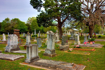 Old Cemetery in Brenham, Tx. taken March 2009..photo is in HDR.  HDR is a set of techniques that allows a greater dynamic range of luminances between light and dark areas of a scene than normal digital imaging techniques.