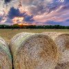 "Hay Bales at Sunset<br /> Though it wasn't perfect weather conditions, I""m glad I tried to shoot this, as the hay bales were gone the next day. It use to be that they would sit there a few weeks. Ranchers are just getting too darn efficient."
