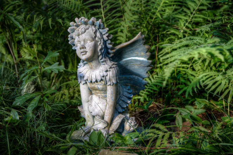 This little garden angel stands watch in a patch of fern at my friends house on the lake, not far from the Blue Frog on a Post. Photo by Tim Stanley Photography.