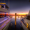 All Tied Up<br /> These boats are resting quietly during another peaceful evening at the Pensacola Marina in Florida.