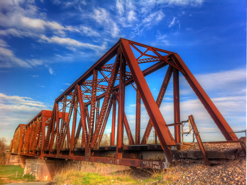 Bridge Over the Brazos<br /> I was driving through a Richmond, a small town southwest of Houston. I was mainly looking for new things to come back and photograph when I had my camera with me. I ran across a viewpoint of the railroad bridge over the Brazos River and had to get out and take a look. I have seen this many times from the highway, but never right by the tracks. Having only my iPhone, I couldn't resist taking a quick test shot to remind me to come back sometime.