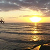 A pano looking east towards the Pleasure Pier from a jetti over the surf.