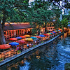 The brightly colored umbrellas over the tables at the Casa Rio restaurant on the Riverwalk in San Antonio, Texas.