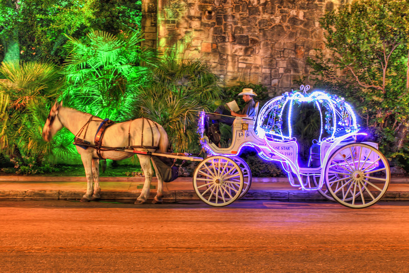 This photo is of a lit-up horse-drawn carriage.  These carriages are located near the Alamo in San Antonio, Texas.  Unfortunately the horse did not hold it's head still during the 10 seconds it took to get this shot!