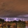 30 seconds of lightning strikes just before the severe thunderstorms rolled through late on the night of 1 November 2010.  I think the large flagpole at Sea World is getting struck by one of the bolts, but to be honest I can't really tell for sure.