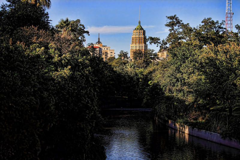 The Tower Life Building (and Drury Plaza Hotel) as seen from a bridge over the Riverwalk in San Antonio, Texas