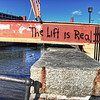 """The Lift is Real"" graffiti near the Inner Harbor in Baltimore, Maryland.<br /> <br /> For more on this photo, please visit my blog post:<br /> <br /> <br />  <a href=""http://brianmoranhdr.blogspot.com/2010/12/lift-is-real.html"">http://brianmoranhdr.blogspot.com/2010/12/lift-is-real.html</a>"