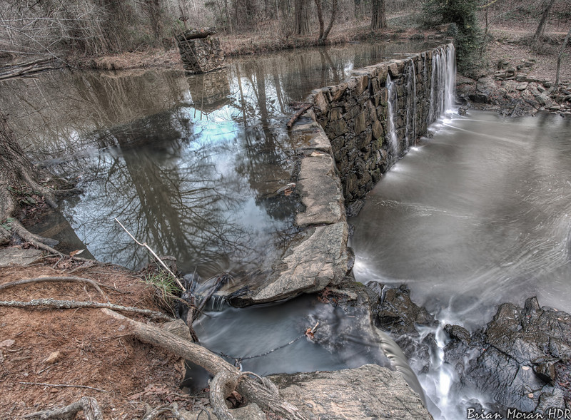"""Vantage point above the Old Mill Dam, located in Cedarock Park in Burlington, North Carolina.<br /> <br /> If you would like to read more about this photo, please visit my blog post:<br /> <br /> <br />  <a href=""""http://brianmoranhdr.blogspot.com/2013/01/old-mill-dam-burlington-north-carolina.html"""">http://brianmoranhdr.blogspot.com/2013/01/old-mill-dam-burlington-north-carolina.html</a>"""