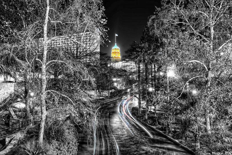 "The view from a walkway across the Riverwalk in San Antonio, Texas.  The building framed by the trees is the Tower Life Building.  The photo was created using Nik Software's Silver Efex Pro.<br /> <br /> <br /> For more on this photo, please visit my blog post:<br /> <br /> <br />  <a href=""http://brianmoranhdr.blogspot.com/2011/02/fun-with-silver-efex-pro.html"">http://brianmoranhdr.blogspot.com/2011/02/fun-with-silver-efex-pro.html</a>"