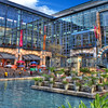 )Note: I redid this photo with Color Efex Pro and added a partly cloudy sky at the top of the photo, I like it much more than my original attempt)<br /> <br /> This is the courtyard for the RiverCenter Mall located in San Antonio, Texas. You can just make out the edge of a Water Taxi on the right. I cleaned up the water in the Riverwalk quite a bit in this picture, so please don't expect it to look this nice should you visit San Antonio!