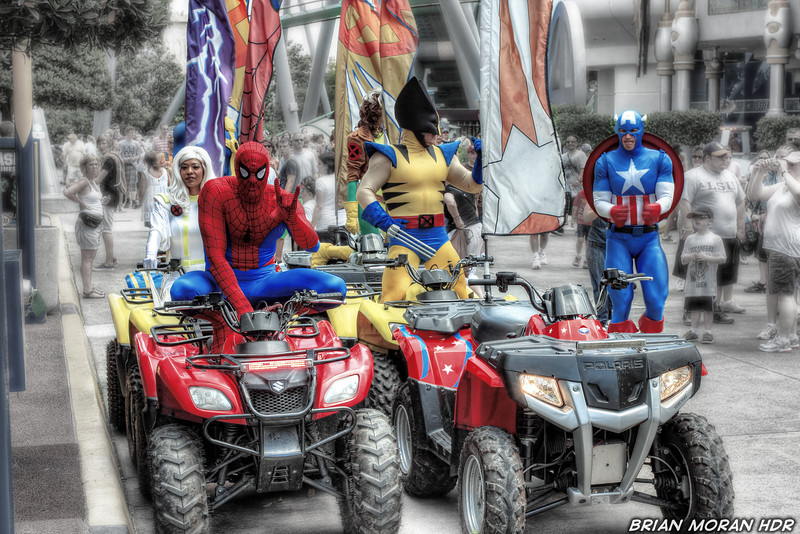 """Storm , Rogue, Spiderman, Wolverine, and Captain America rushing to their vehicles to respond to a distress siren at Universal Studios """"Islands of Adventure"""" in Orlando, Florida.<br /> <br /> If you would like to read more about this photo, please visit my blog post:<br /> <br /> <br />  <a href=""""http://brianmoranhdr.blogspot.com/2011/05/superhero-island.html"""">http://brianmoranhdr.blogspot.com/2011/05/superhero-island.html</a>"""