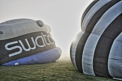 Balloons being inflated in early morning mist at the Headcorn Areodrome Balloon Event 2013