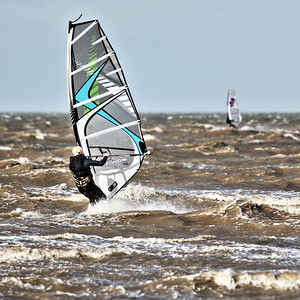Windsurfers enjoying the strong winds at Minnis Bay, Kent