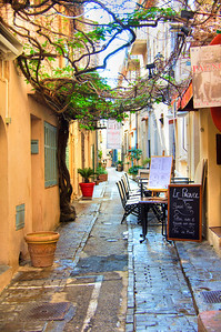 Sidewalk cafe on a side street in St. Tropez, France.