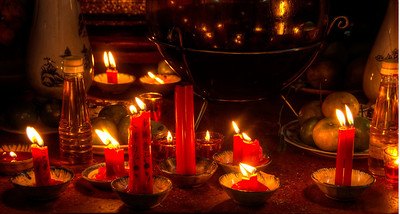 Candles burn in a Chinatown Buddhist temple.