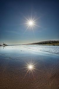 Bali Sun in a mirror