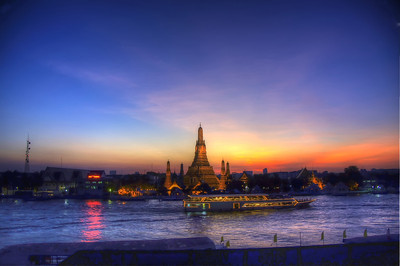 "Sunset at the Wat Arun, ""Temple of Dawn"", on the west  bank of the Chao Phraya River in Bangkok, Thailand."