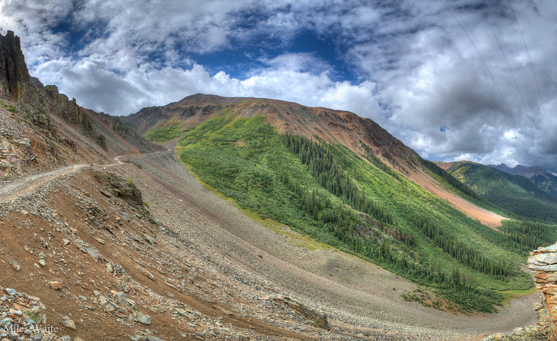 A panorama shot of the road leading up to Ophir pass.