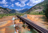 Drone shot of the Durango Silverton train tracks, crossing over the Animas River. Silverton in the distance.