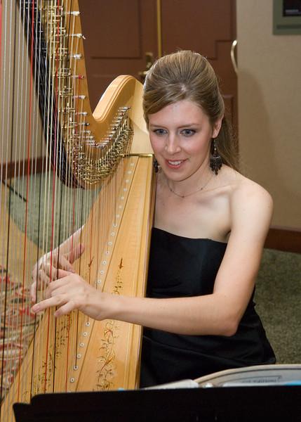 Lauren Meier, HEB ISD elementary teacher and harpist at silent auction during gala.