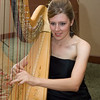 Lauren Meier, HEB ISD elementary teacher and harpist at silent auction during gala.