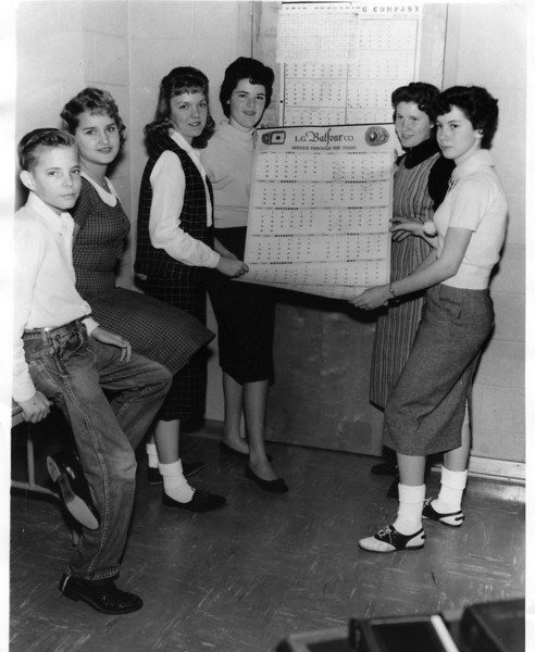 Bell: Harkins Rea, Donna Wooley, and (?) holding a Balfour 58-59 calendar.  <br /> <br /> -Submitted by Lynnelle Rea