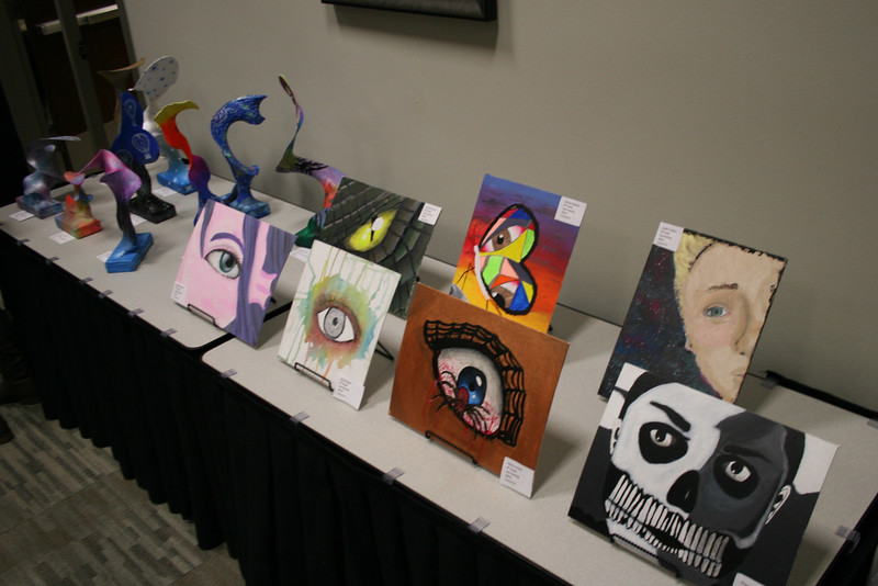 Paintings and sculptures done by students.