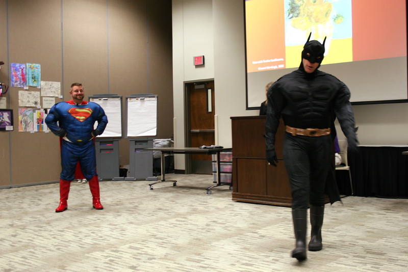 Superman and Batman have a stand-off.