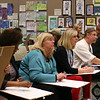 School board members draw their version of an object.