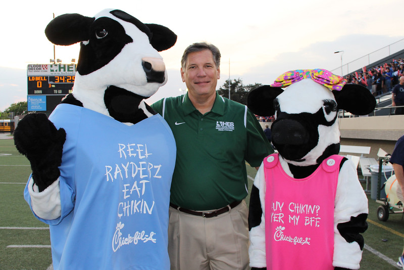 Superintendent with Chick-fil-a cows.