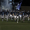 The L.D. Bell football team running onto the field.