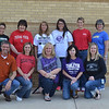 Teachers wearing shirts from their colleges.
