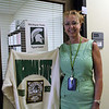District official holding shirt from their college.