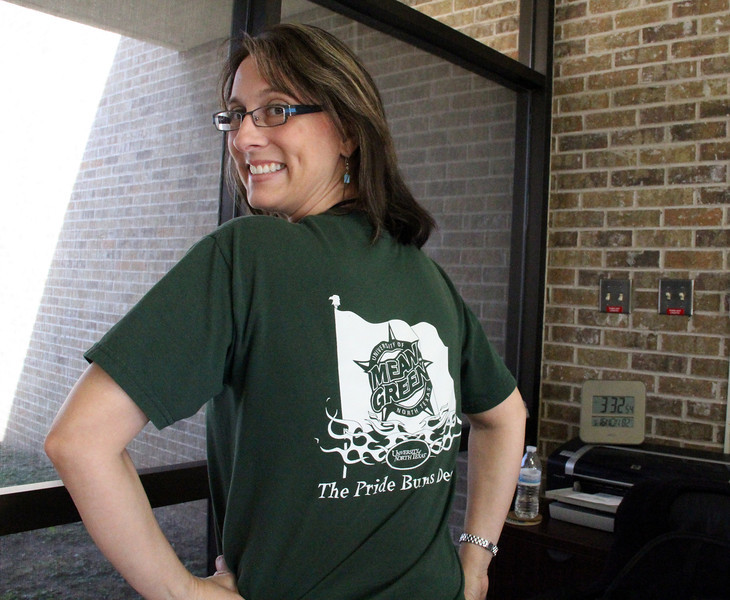 District official wearing shirt from their college.
